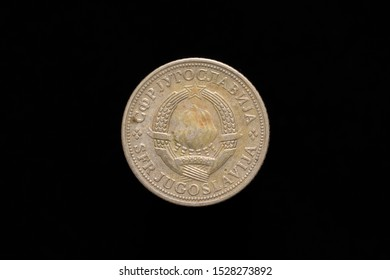 Socialist Federal Republic of Yugoslavia old 2 Dinara coin from 1972, obverse showing the state emblem of Yugoslavia. Isolated on black background