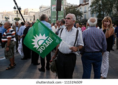 Socialist party supporters wave flags during party leader Fofi Gennimata addresses in Athens, Greece on  Sep. 15, 2015