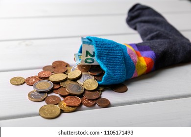sock full with euro money. savings and hiding concept