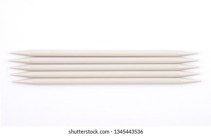 Sock knitting needles on white background