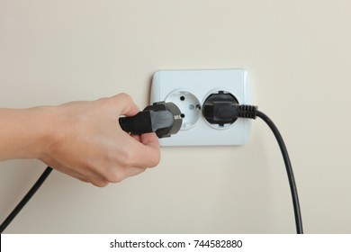 Socket with electric plug in the wall. Copy space. The concept of energy savings.