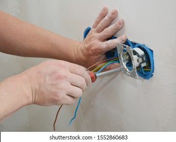 Socket plug installation. Electrican repair and installing socket, outlet plug.