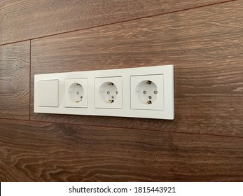 sockets on a laminate background, 3 sockets and a switch