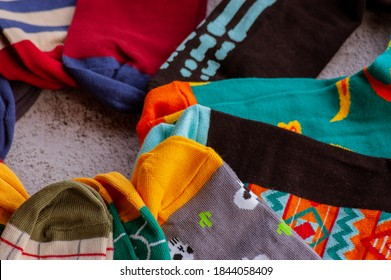 Socks colorful. Set of socks. Colorful socks. Knitted socks on a gray background