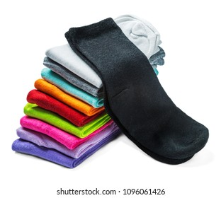 socks of different color are isolated on white. The stack of socks