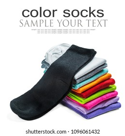 socks of different color are isolated on white. The stack of socks. Text delete