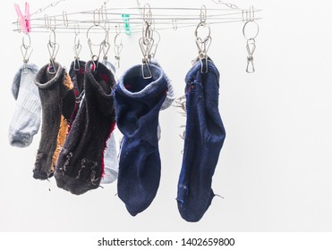 Socks that wash Left to dry on the clothesline