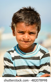 SOCOTRA, YEMEN - JAN 12, 2014: Unidentified Yemeni little boy on the beach of the Island of Socotra. Children in Socotra live in poverty and grow without education