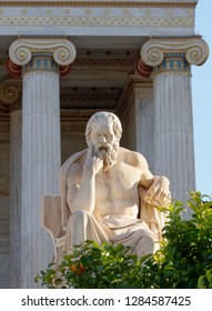Socrates the ancient greek philosopher in front af the national academy neoclassical building, Athens Greece