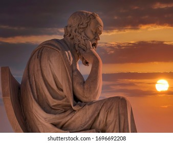 Socrates the ancient Greek philosopher marble statue under dramatic sky
