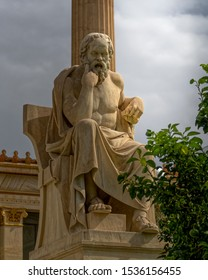Socrates the ancient Greek philosopher sitting in deep thoughts staue, Athens Greece