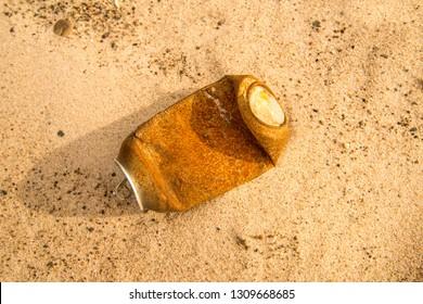 soda can on a beach