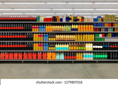 Soda pop cans and plastic cola bottles on shelves. Suitable for mockup and business presentation.
