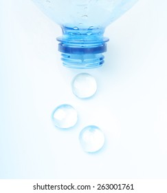 Soda water bottle with water drops isolated on white