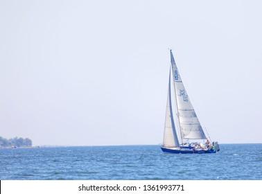 SODERARM, SWEDEN - JUL 18, 2018: Sailship on the blue ocean in the swedish archipelago, islets in the background. July 18 2018, Soderarm, Sweden