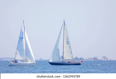 SODERARM, SWEDEN - JUL 18, 2018: Two sailship on the blue ocean in the swedish archipelago, islets in the background. July 18, 2018, Soderarm, Sweden