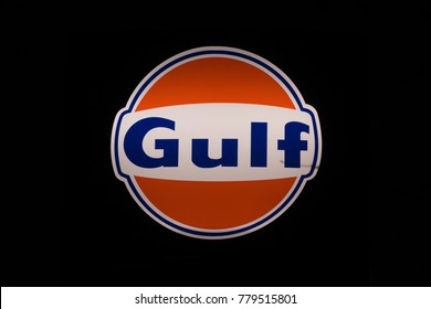 SODERTALJE, SWEDEN - DEC 20, 2017: The oil company Gulf sign during early morning lit up in orange and blue.