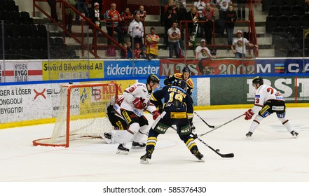 Sodertalje, Sweden - January 15, 2017: Lucas Carlsson scores the goal in Ice hockey match in hockeyallsvenskan between SSK and MODO in the sports complex Scaniarinken