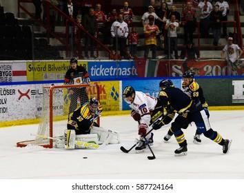 Sodertalje, Sweden - January 15, 2017: Per-Ake Skroder, MODO try to score goal in the Ice hockey match in hockeyallsvenskan between SSK and MODO in the sports complex Scaniarinken