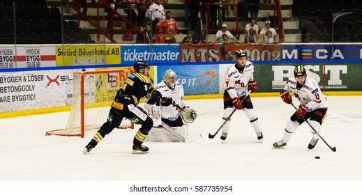 Sodertalje, Sweden - January 15, 2017: David Rundqvist, MODO try to score goal in the Ice hockey match in hockeyallsvenskan between SSK and MODO in the sports complex Scaniarinken