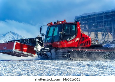 SOELDEN, AUSTRIA, January 10 2018: Snow grooming machine on its way to work at ski slopes during winter day in Soelden, Austria.