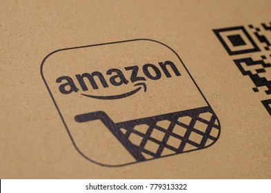 Soest, Germany - December 19, 2017: The Amazon Logo on cardboard envelope. Amazon.com, Inc., is an American electronic commerce and cloud computing company.