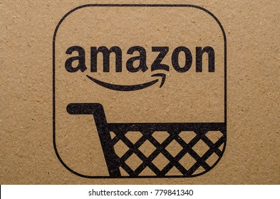 Soest, Germany - December 19, 2017: The Amazon Logo with QR code on cardboard envelope. Amazon.com, Inc., is an American electronic commerce and cloud computing company. Illustrative editorial