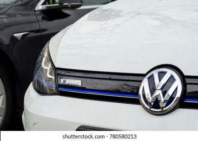 Soest, Germany - December 23, 2017: Close-up - the front of the white Volkswagen e-Golf car with the company logo.