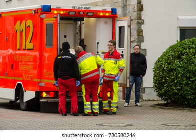 Soest, Germany - December 23, 2017: Medical brigade near ambulance service car. (Marienkrankenhaus Soest gGmbH)