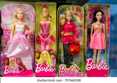 Soest, Germany - January 12, 2018: Barbie Toys for sale in the Supermarket Stand. Barbie is a fashion doll manufactured by the American toy company Mattel, Inc. and launched in March 1959.