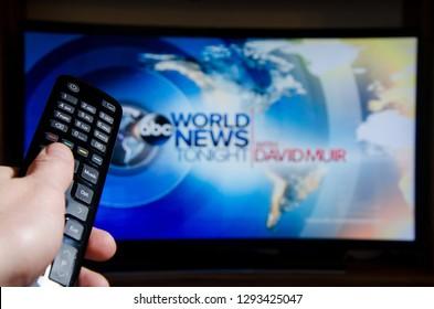 Soest, Germany - January 13, 2019: Man watching ABC World News Tonight With David Muir on TV.