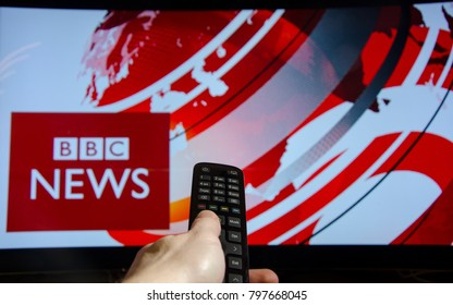 Soest, Germany - January 14, 2018: Man watching BBC News on TV. BBC News is an operational business division of the British Broadcasting Corporation (BBC).