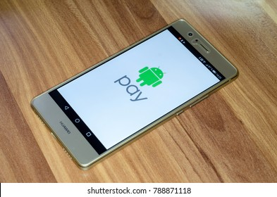 Soest, Germany - January 4, 2018: Android Pay logo on screen of Huawei P9 lite. Android Pay is a digital wallet platform developed by Google to power in-app and tap-to-pay purchases on mobile devices