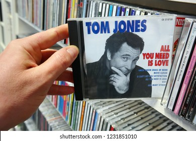 "SOEST, THE NETHERLANDS - APRIL 15, 2016: ""All You Need Is Love"" a compilation CD record of the Welsh pop singer Tom Jones, in a second hand store."