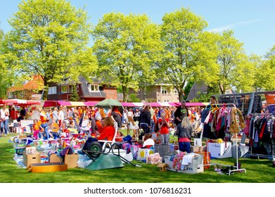 SOEST, NETHERLANDS - April 27, 2017. Dutch people buy and sell secondhand stuff at the outdoor Vrijmarkt flea market on Koningsdag (Kings Day Holland, Kingsday). Near Amsterdam.
