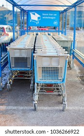 SOEST, NETHERLANDS - February 28, 2018. Supermarket carts of Ahold Albert Heijn Delhaize (AH) super market chain and Dutch text 'take here your trolley'.