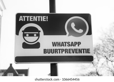 SOEST, THE NETHERLANDS. JANUARY 2018. Black and white WhatsApp neighbourhood watch sign to scare away thieves and criminals.