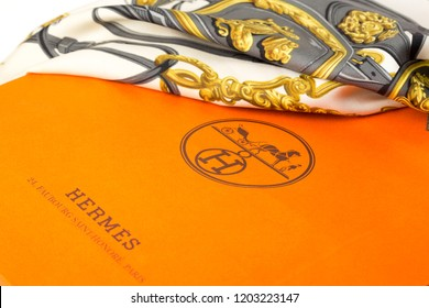 SOEST, THE NETHERLANDS, OCTOBER 2018. Close-up of a beautiful vintage 1970s silk Hèrmes scarf, series ´Brides de Gala´ with orange Hermes shopping bag. Illustrative editorial.