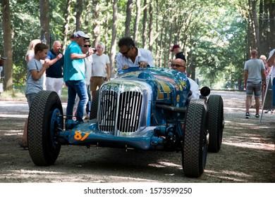 Soestdijk, The Netherlands - AUG 24, 2019: a vintage race car during a sprint rally at Concours d'Elegance Paleis Soestdijk.