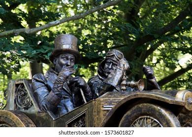 Soestdijk, The Netherlands - AUG 24, 2019: living statues in an old car at classic car event Concours d'Elegance Paleis Soestdijk.