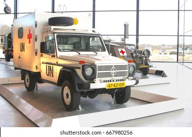 SOESTERBERG, NETHERLANDS - February 20, 2015. Vintage classic ambulance car of intergovernmental United Nations organization with red cross icon and UN logo in National Military Museum.