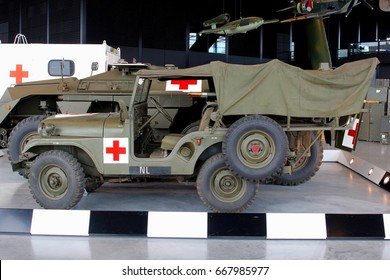 SOESTERBERG, NETHERLANDS - February 23. Old Dutch military ambulance jeeps with a red cross icon in the National Military Museum on February 23, 2015 in Soesterberg.