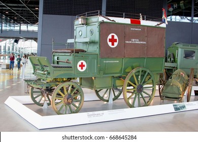 SOESTERBERG, SOEST, NETHERLANDS - February 23. Very old ambulance cart from 1906 with classic red cross logo and children walk around in National Military Museum on February 23, 2015 in Soesterberg.