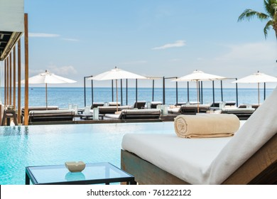 Sofa beside swimming pool in beach resort during vacation in holiday at hua hin thailand