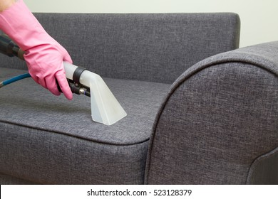 Sofa chemical cleaning with professionally extraction method. Upholstered furniture professionally chemical cleaning in hotel and house. Early spring cleaning or regular clean up.