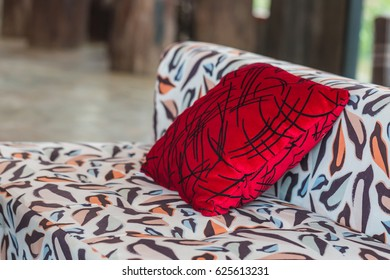 Sofa colorful with red fabric pillow.
