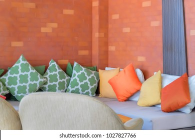 Sofa corner of L-shape sofa sofa with colorful pillow in coffee cafe
