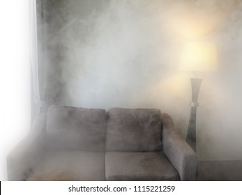 sofa and  lamp in smoke. Black and white in The house is mysterious and old.