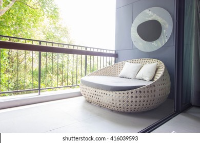 Sofa on the balcony with garden view.