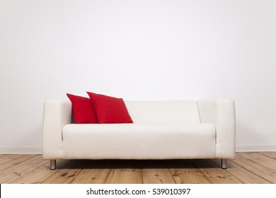 Sofa and space on wall